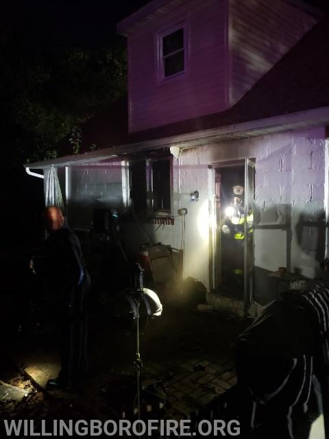 Captain Gardner exiting the rear of the home after the fire was under contrl